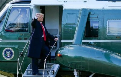 President Donald Trump gestures as he boards Marine One on the South Lawn of the White House,